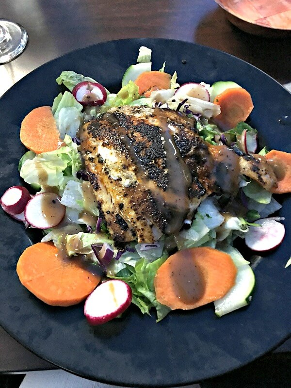 Salad topped with grouper
