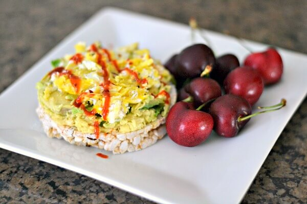 Rice cake with avocado and scrambled eggs