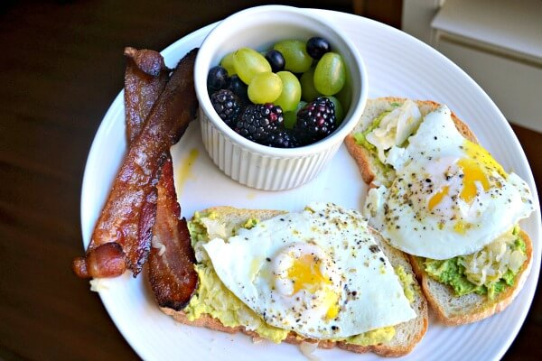 Eggs and avocado toast with bacon