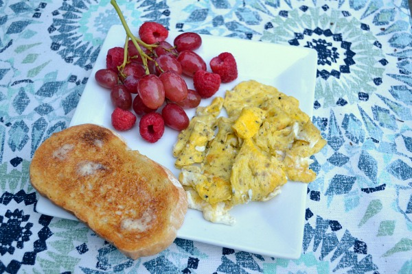 Two scrambled eggs, grapes and sourdough toast.