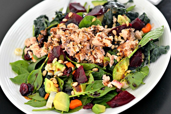Spinach, kale, beets, avocado, dried cranberries, hearts of palm, carrots, pine nuts, canned salmon and homemade balsamic vinaigrette.