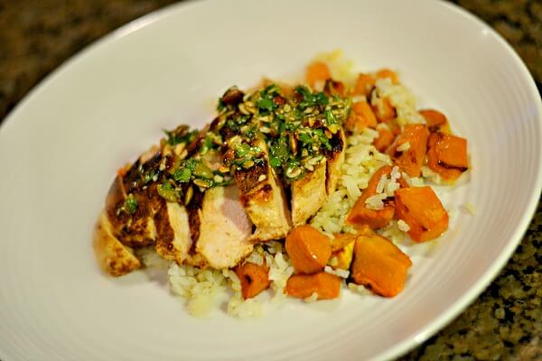 seared chicken with roasted honeycut squash and rice and green mole sauce