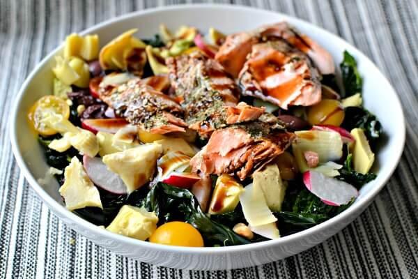 massaged kale salad with lacinto kale (massaged in olive oil, lemon juice and sea salt), radishes, artichokes, avocado, kalamata olives, tomatoes, pine nuts and leftover salmon.