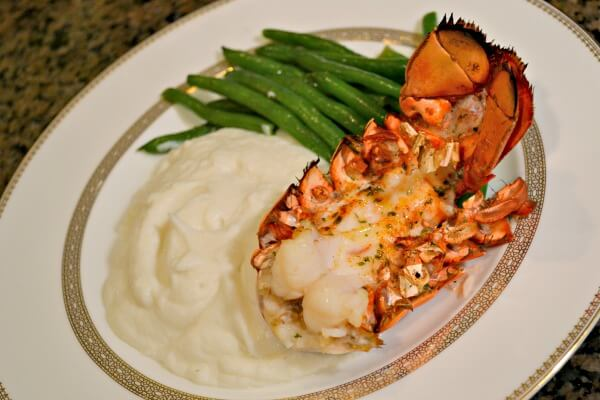 lobster tail with steamed green beans and pureed asparagus
