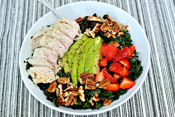Massaged kale with toasted pecans, dried cherries, strawberries, avocado and sliced turkey.