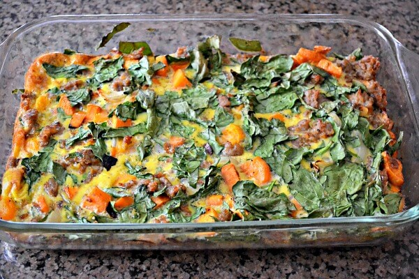 A delicious egg casserole with sweet potatoes, butternut squash, sausage and spinach that can be prepped ahead. Whole30 and Paleo approved!