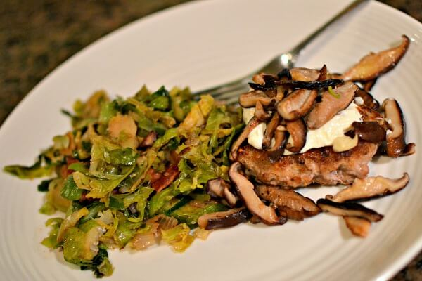 Turkey burgers topped with homemade mayo and sauteed mushrooms with sauteed shredded brussels sprouts cooked with bacon