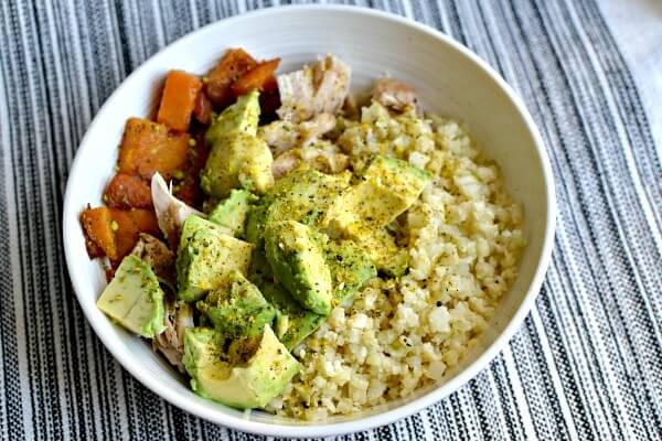 Cauliflower rice, chicken, butternut squash and avocado with a hefty dose of Be Runa Curry Seed Salt on top.