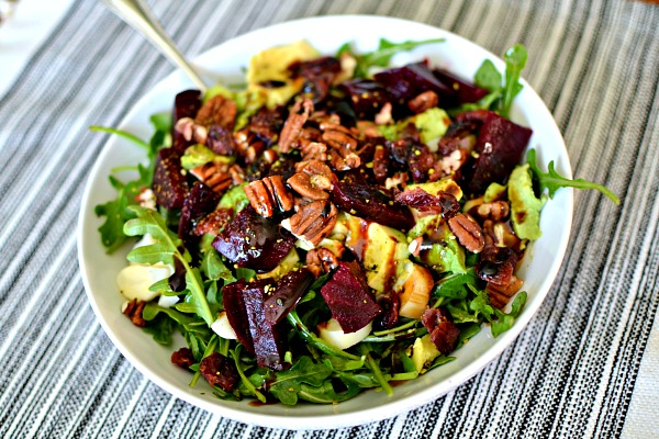 Arugula, hearts of palm, beets, pecans, avocado, dried cranberries and be Runa seed salt.