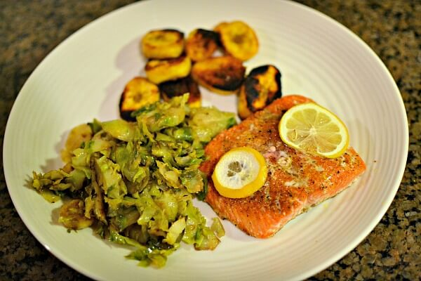 Salmon with shredded brussels sprouts and fried plantains
