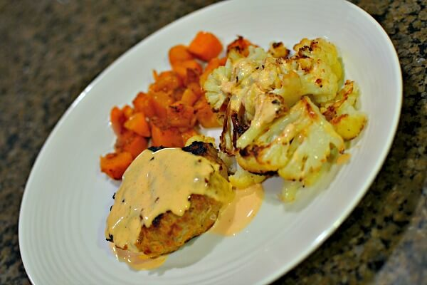 Thai red curry turkey burgers topped with a sauce I whipped up with mayo, lime juice, salt and sriracha. Served with roasted cauliflower and roasted butternut squash.