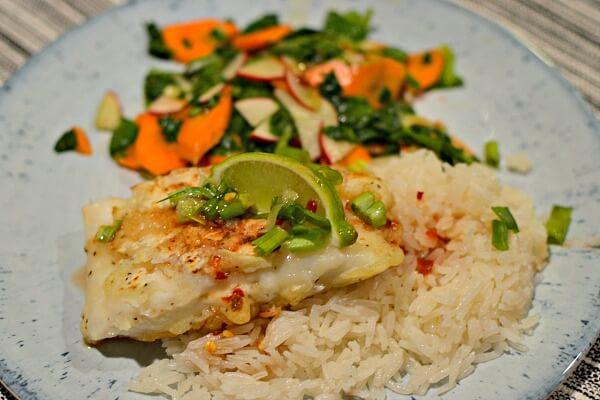 Tempura fried cod over jasmine rice with a Thai-style vegetable salad.