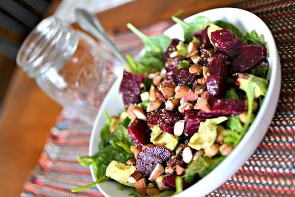 Spinach and arugula with avocado, roasted beets, roasted chopped almonds, leftover pan-roasted chickpeas, and dried cranberries. Olive oil and balsamic to dress.