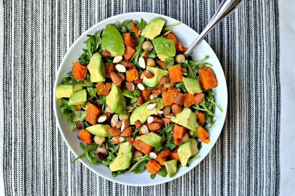 Arugula tossed with Tahini Turmeric Dressing topped with avocado, roasted butternut squash, toasted almonds, dried cranberries and chickpeas.