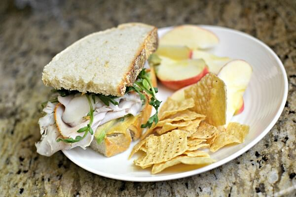 Turkey sandwich with melted goat cheese, arugula, dijon mustard, avocado and mayo