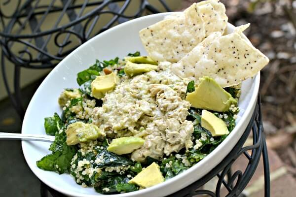Leftover tuna salad on top of a kale quinoa salad