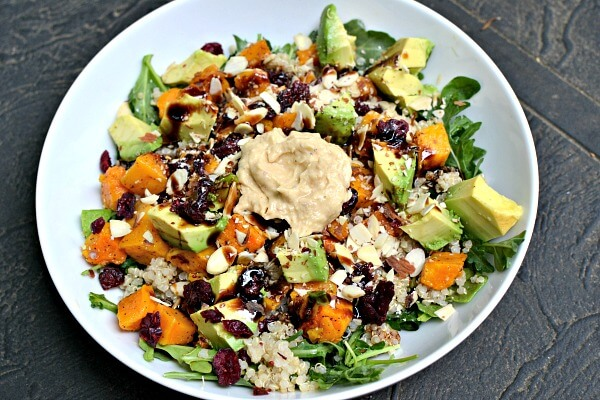 Quinoa, arugula, butternut squash, avocado, dried cranberries, sliced almonds, hummus and dried cranberries