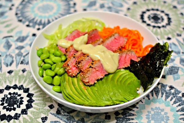 Brown rice tossed with a little rice wine vinegar and some coconut aminos and topped with spiralized carrots and zucchini, edamame, avocado, dried seaweed, sesame crusted yellowfin tuna and wasabi aioli.