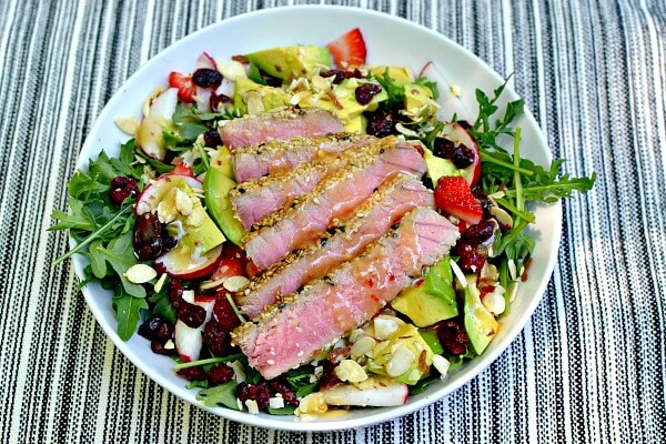 Arugula, dried cranberries, radishes, sliced almonds, avocado, strawberries and sesame crusted yellowfin tuna with a sesame ginger dressing.