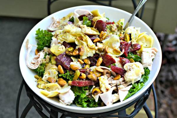 Massaged kale with artichoke hearts, turkey breast, pistachios, pickled beets, olives, a quinoa blend and Tessemae's green goddess dressing.