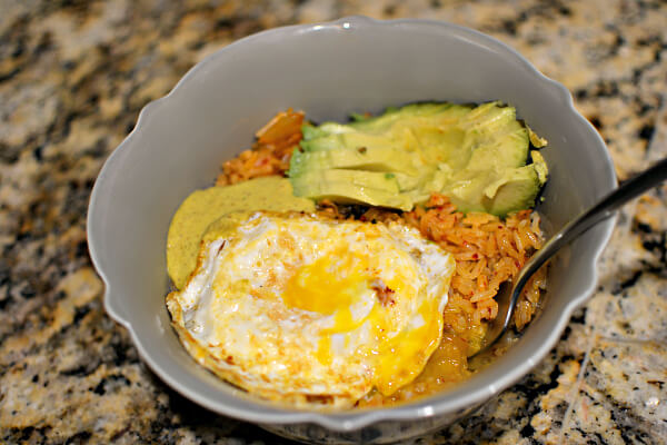 Kimchi fried rice bowl with Mmm sauce, avocado and a fried egg.