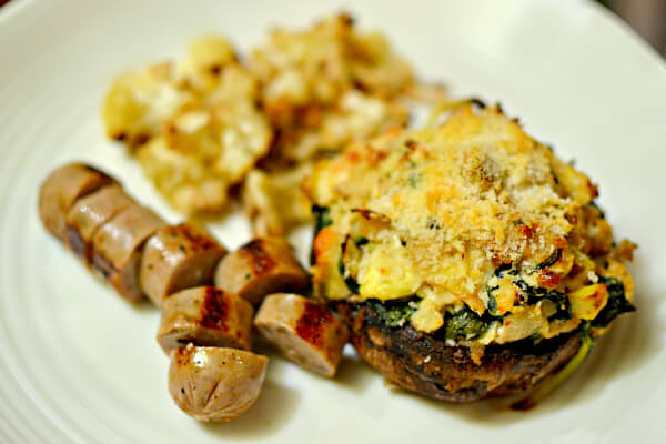 Spinach and artichoke stuffed portobellos with sautéed chicken sausage and roasted cauliflower