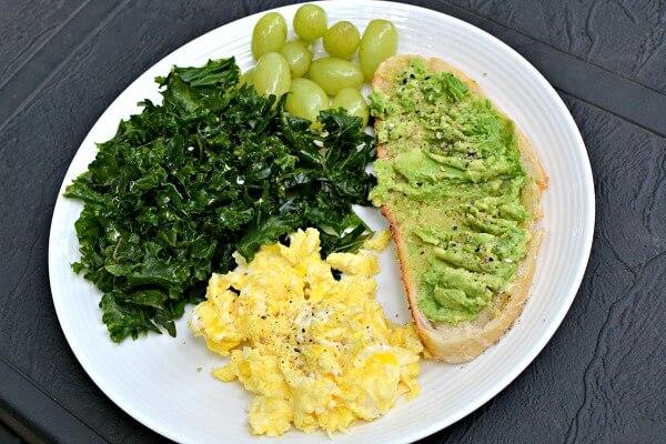 Massaged kale, grapes, avocado toast and scrambled eggs.