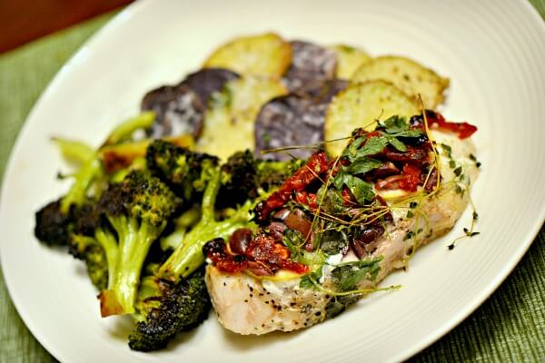 Grouper in parchment with sundries tomatoes, herbs, lemon and kalamata olives. Roasted broccoli and parmesan potatoes on the side.