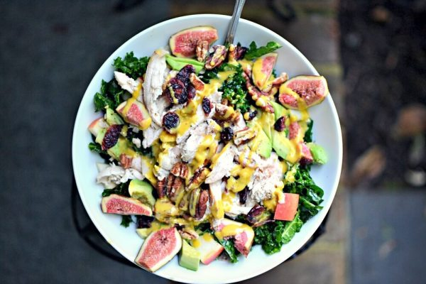 Salad with two types of massaged kale, chicken, figs, avocado, plus, pecans and dried cranberries with tahini turmeric dressing.