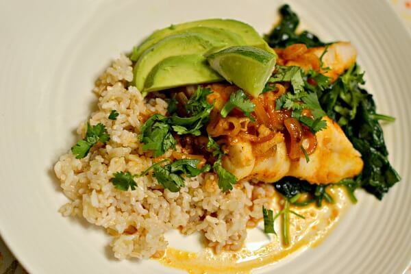 Red coconut curry cod over brown rice with sauteed spinach, cilantro and avocado.