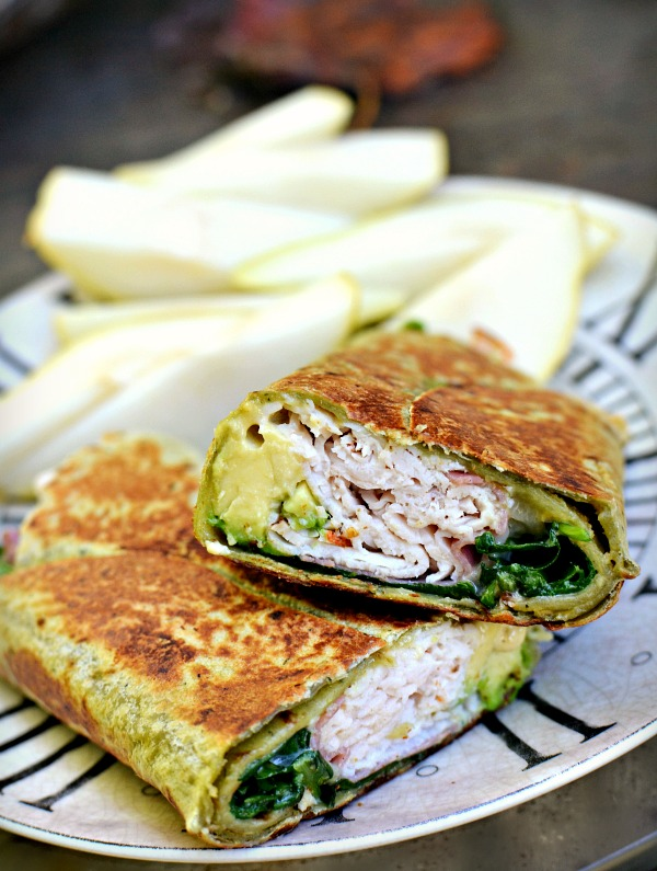 Cedar's spinach wrap with dijon mustard, mayonnaise, avocado, turkey, two slices of salami, white cheddar cheese and spinach. I heated/pressed it in a skillet and served it with a sliced pear.