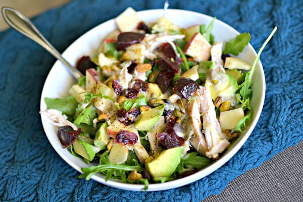 Arugula, shredded chicken, avocado, dried cranberries, avocado, apples, pistachios and some kind of creamy ranch dressing.