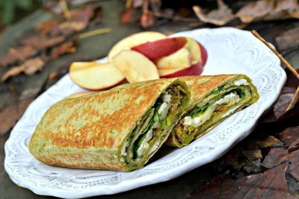 Veggie burger wrap with egg white, hummus and spinach