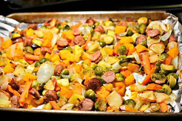 Fall-inspired one-pan roasted inner. Butternut squash, carrots, chicken-apple sausage, brussel sprouts, apples and onions.