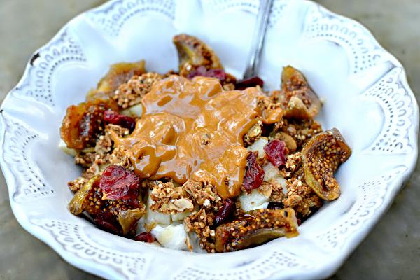 Plain full-fat greek yogurt (Fage is my favorite brand), Purely Elizabeth granola, dried cranberries, defrosted Trader Joe's semi-frozen figs and Wild Friends peanut cashew super butter.