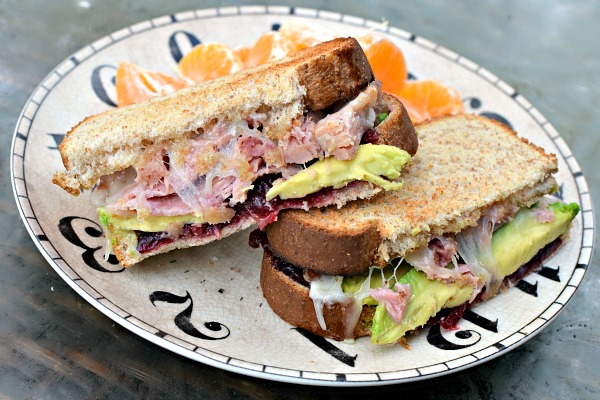 Ham sandwich with avocado, cranberry sauce, mayo and provolone cheese. Again on honey wheat and again melted under the broiler.