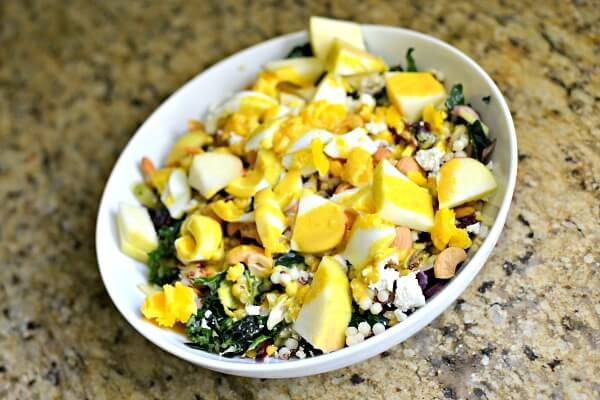 kale and grains salad with egg, feta and apples
