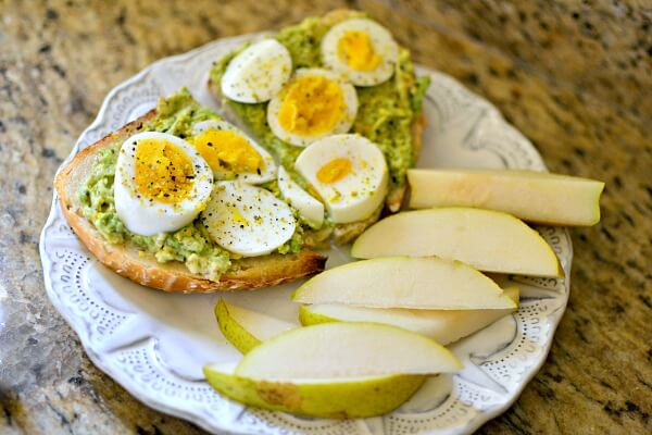 Avocado toast with mayo, sea salt, a hardboiled egg and truffle seed salt
