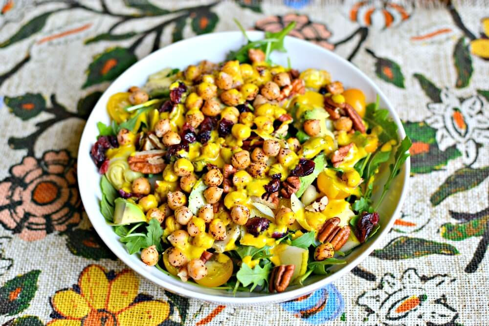 Arugula, pears, pecans, cranberries, avocado, pan-roasted chickpeas, artichoke hearts, yellow cherry tomatoes and Trader Joe's Almond Butter Turmeric dressing.