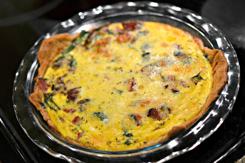 Quiche with ham, mushrooms, spinach, cheese and shallots