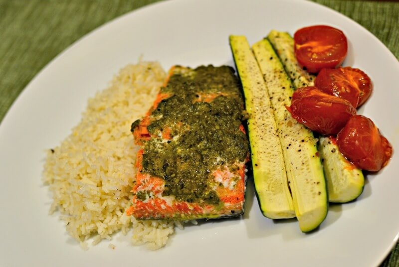 pesto baked salmon with zucchini, tomatoes and lemon-herb rice