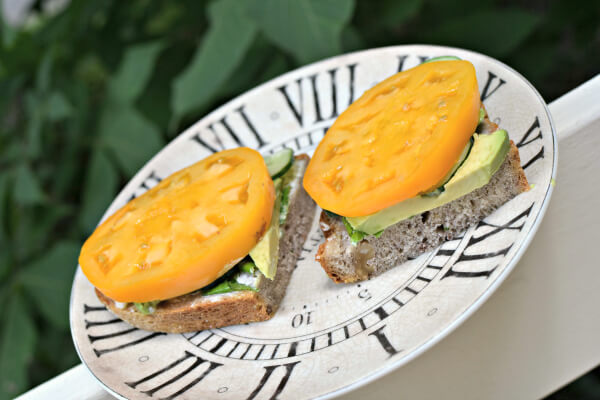 Open-face tomato, cucumber, avocado, basil and mayo on a blue cheese/walnut bread.