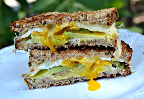Egg and cheese on Dave's Killer Bread Good Seed with mayo and avocado