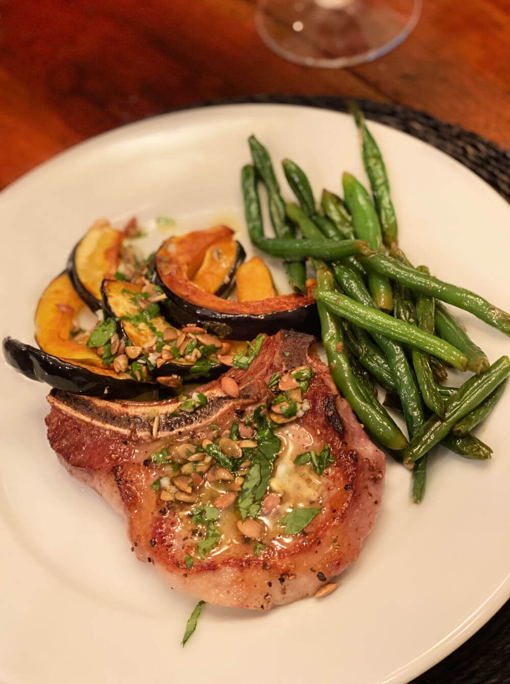 pork chop with pumpkin seed vinaigrette, roasted acorn squash and garlicky green beans