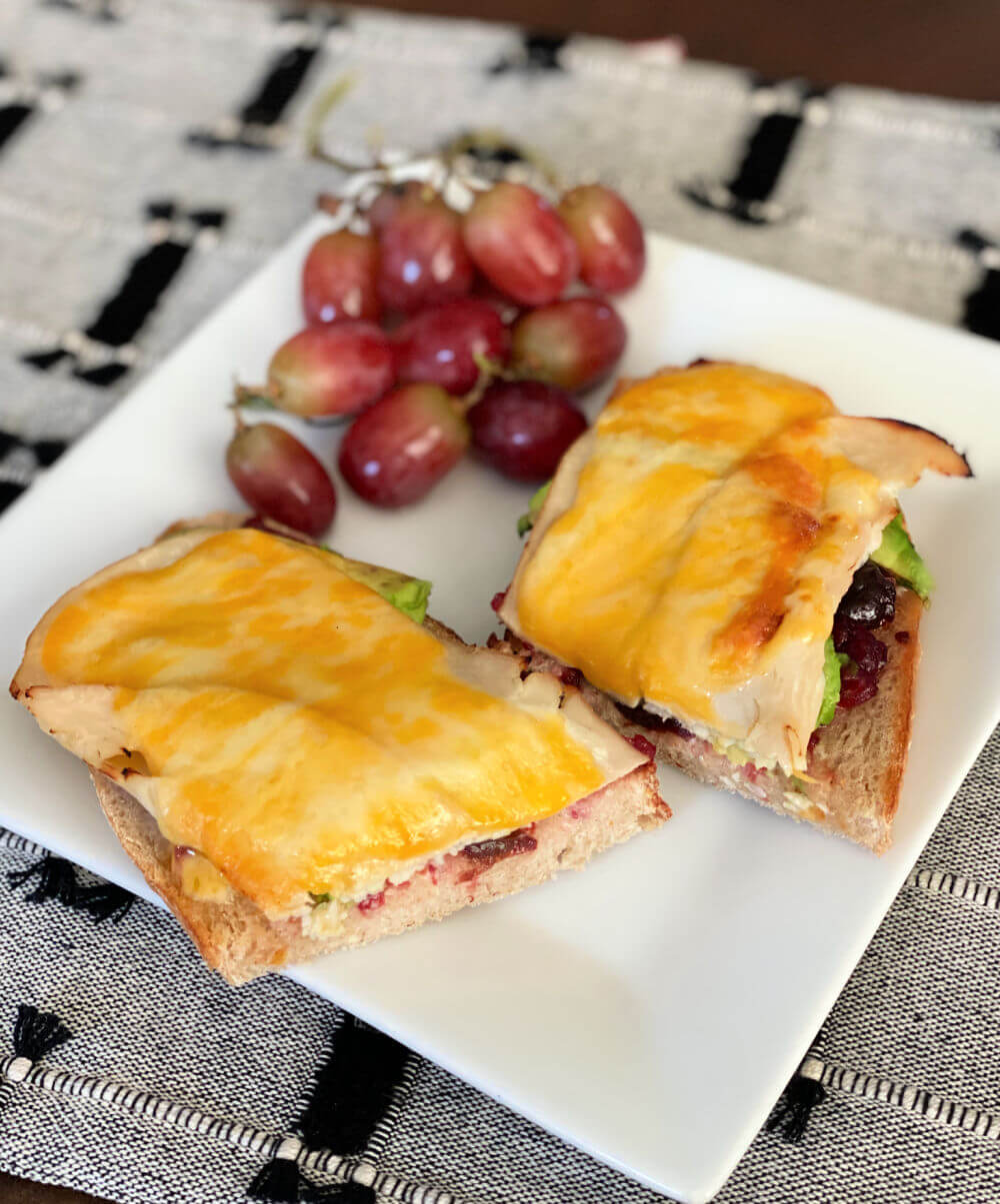 open-faced turkey sandwich with cranberry sauce and colby-jack