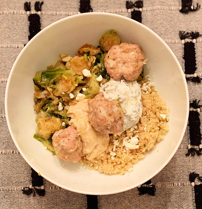 turkey meatball bowl with couscous and sautéed shredded brussel sprouts
