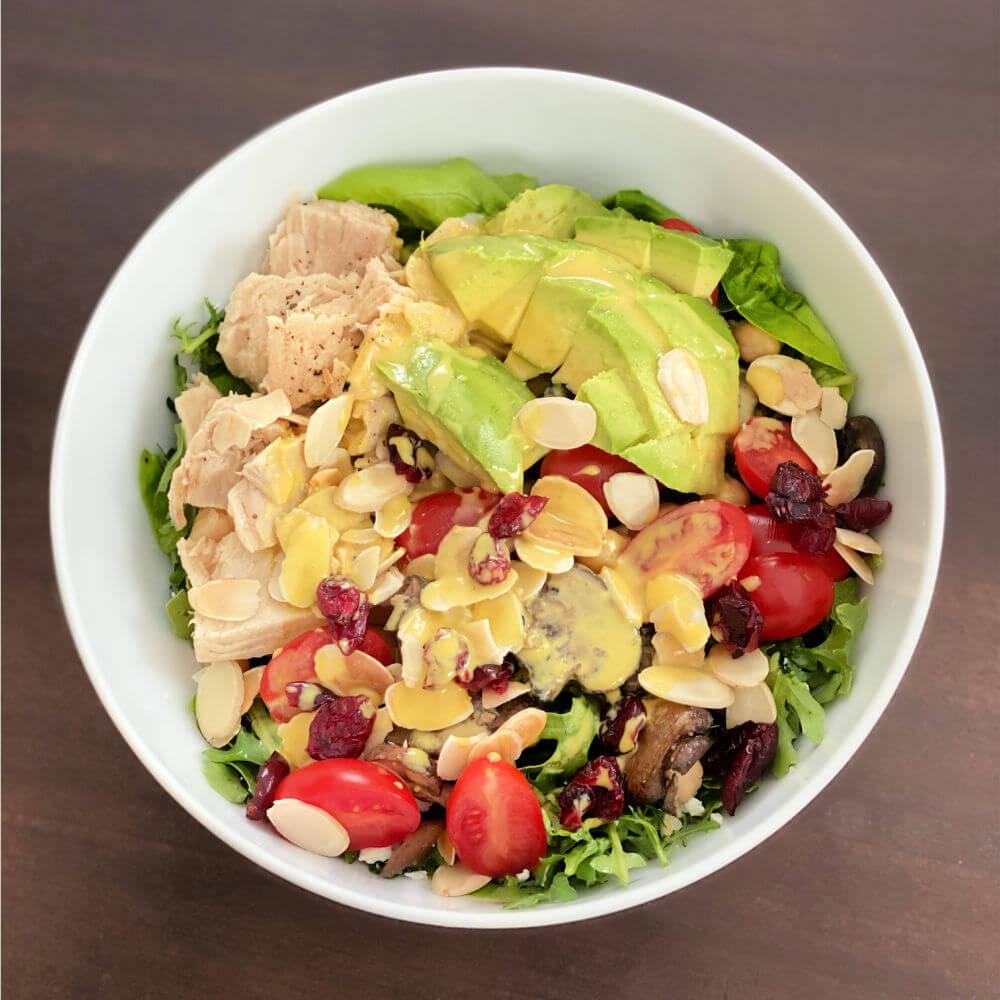 salad with tuna, avocado and tahini dressing