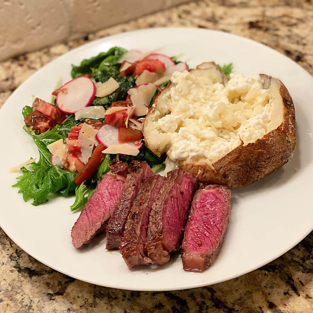 grass-fed ribeye and baked poato