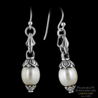 This is a nice pair of sterling and pearl dangle earrings
