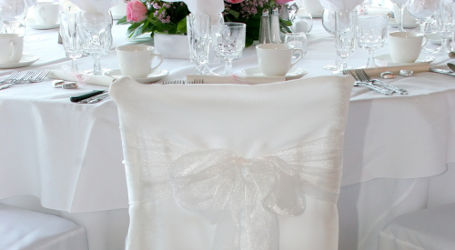 chic chair covers birmingham toddler foam for hire to refresh old dated seating cover white with organza bow